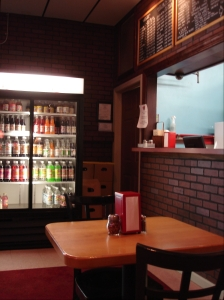 A case of Foxon Park sodas completes the classic takeout joint interior.